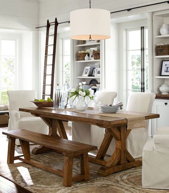 Neutral Dining Room Slipcovered Chairs Bench Trestle Table Library Ladder Modern Farmhouse Dining Room Modern Farmhouse Dining Farmhouse Style Dining Room