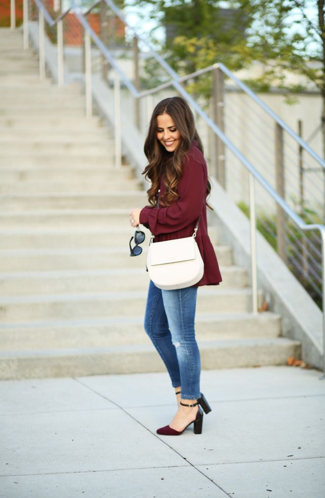 corilynn. Burgundy blouse+ripped skinny jeans+black and burgundy ankle  strap pumps+white crossbody bag+sunglasses. Fall Casual Business Outfit 2016 26936da11