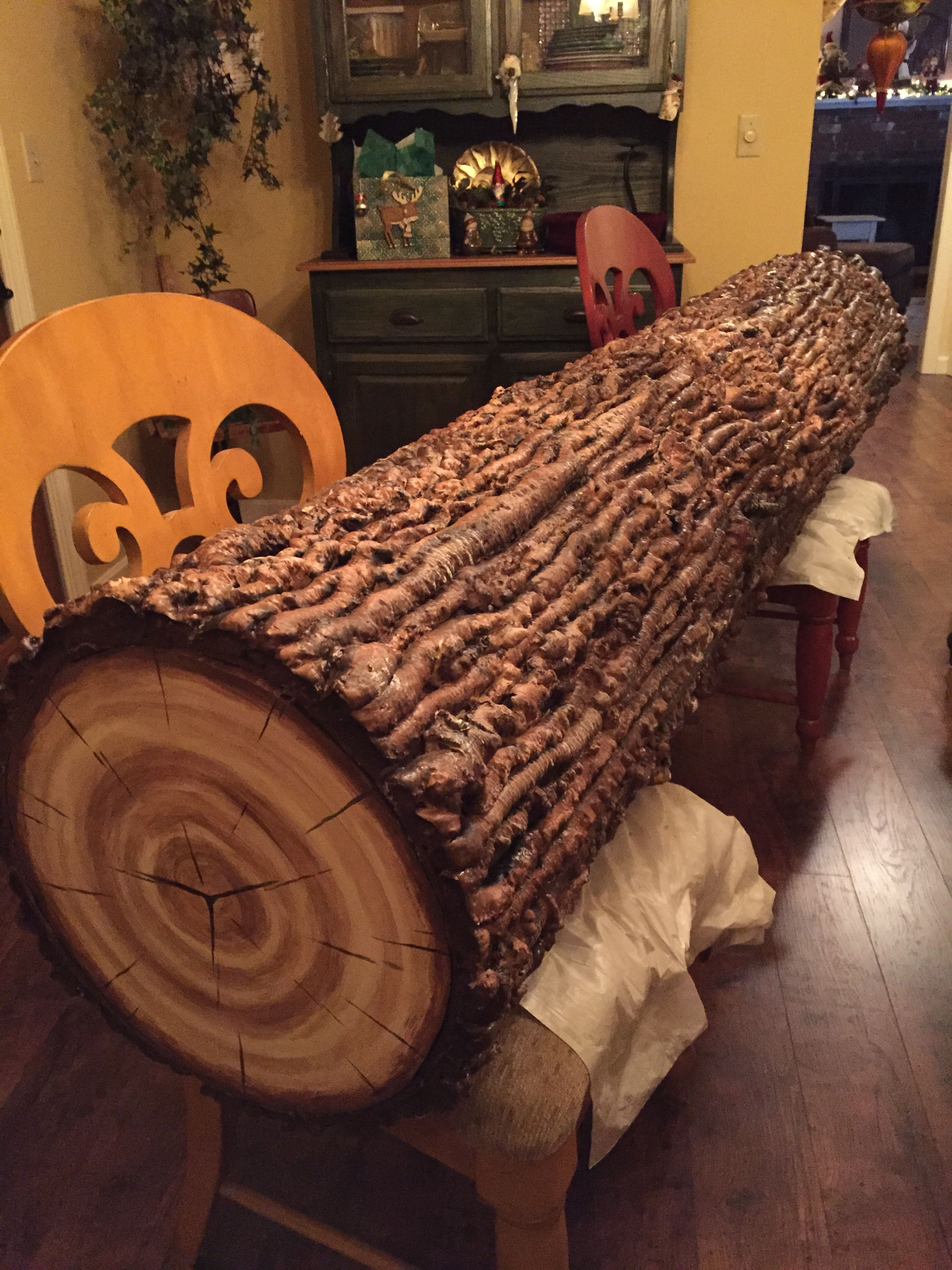 Faux log made with canned insulating spray foam