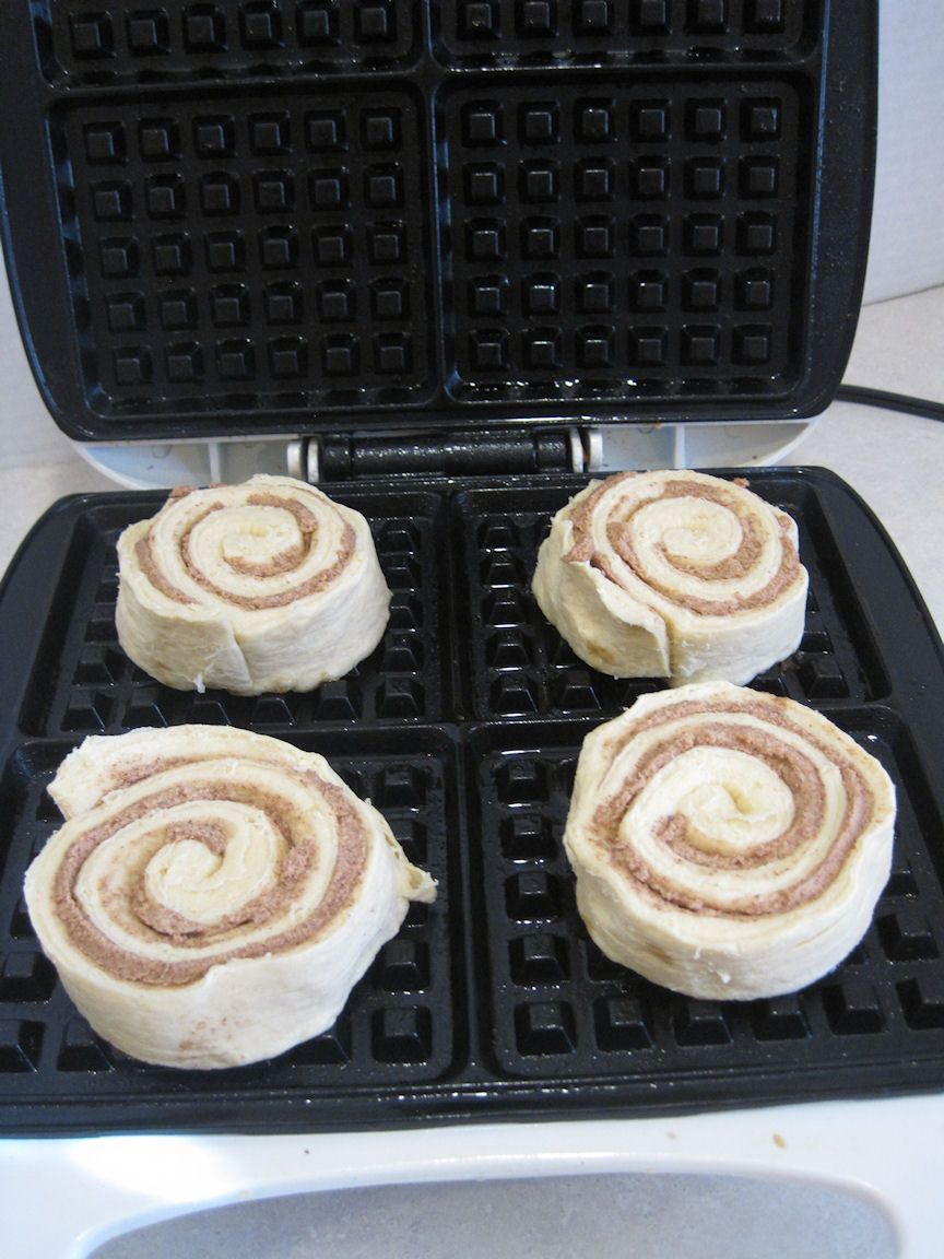 Spray waffles iron with cooking spray, place 4 cinnamon rolls on waffle iron and close to cook.Cook until light goes off a the waffles are cooked through. Make sure you close the waffle maker completely. I locked it closed so the waffle maker would smash the cinnamon rolls.