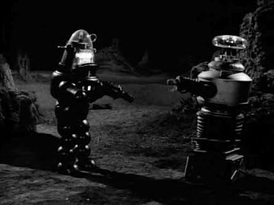 Robby the Robot from _Forbidden Planet_ meets the Class M-3 Model B9, General Utility Non-Theorizing Environmental Control Robot from _Lost In Space_