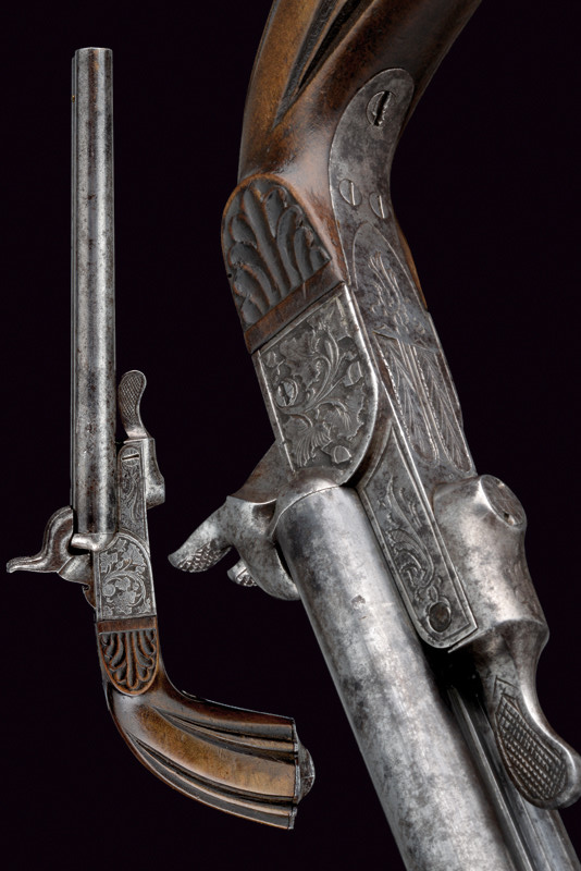 A double-barrelled pin-fire pistol.    provenance: France dating: third quarter of the 19th Century.