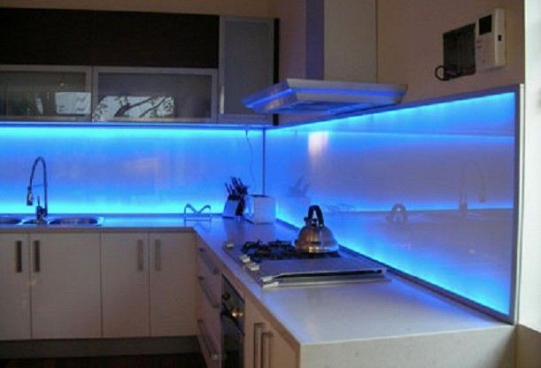 White Kitchen Cabinets With Blue Glass Backsplash Inspirational