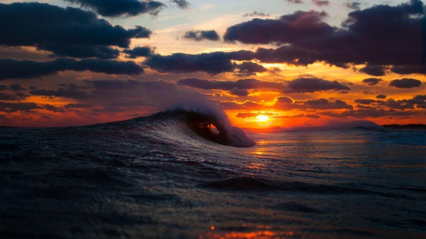 Download Wallpaper 1366x768 Sea Surf Wave Sunset Laptop
