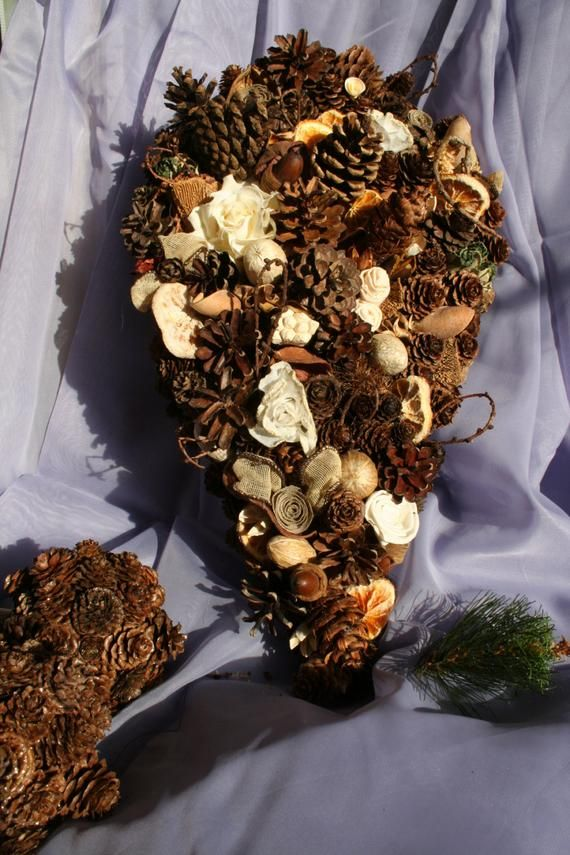 Pine Cone and Flower Bouquet for your Rustic Wedding #pineconeflowers