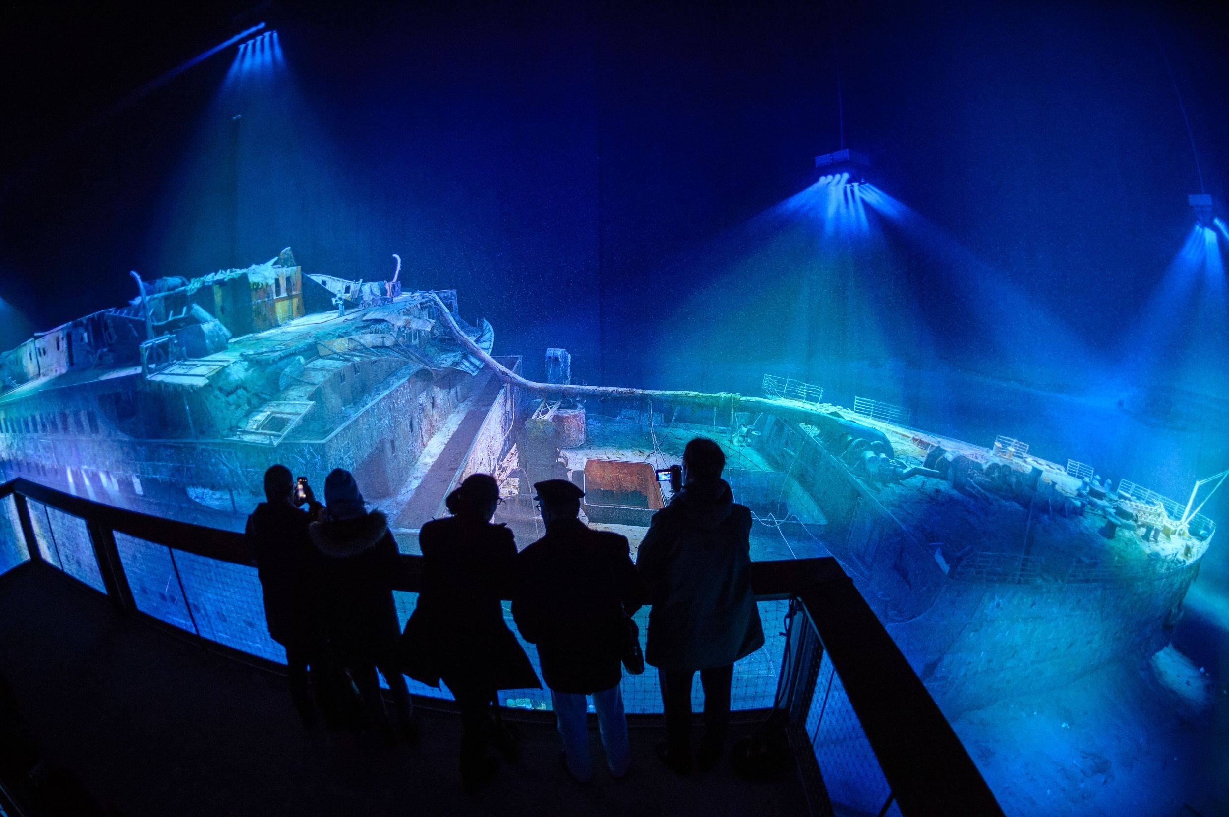 LEIPZIG, GERMANY - JANUARY 27: People look at a large-scale 360 degree panorama presentation of the Titanic shipwreck by artist Yadegar Asisi during a press preview on January 27, 2017 in Leipzig, Germany. The view of the wreck simulates a vantage point 3,800 meters below sea level and the work is meant to illustrate mankind's hubris in seeking to overcome the laws of nature. Yadegar Asisi has created a variety of large-scale panoramas in recent years that deal with significant historical…