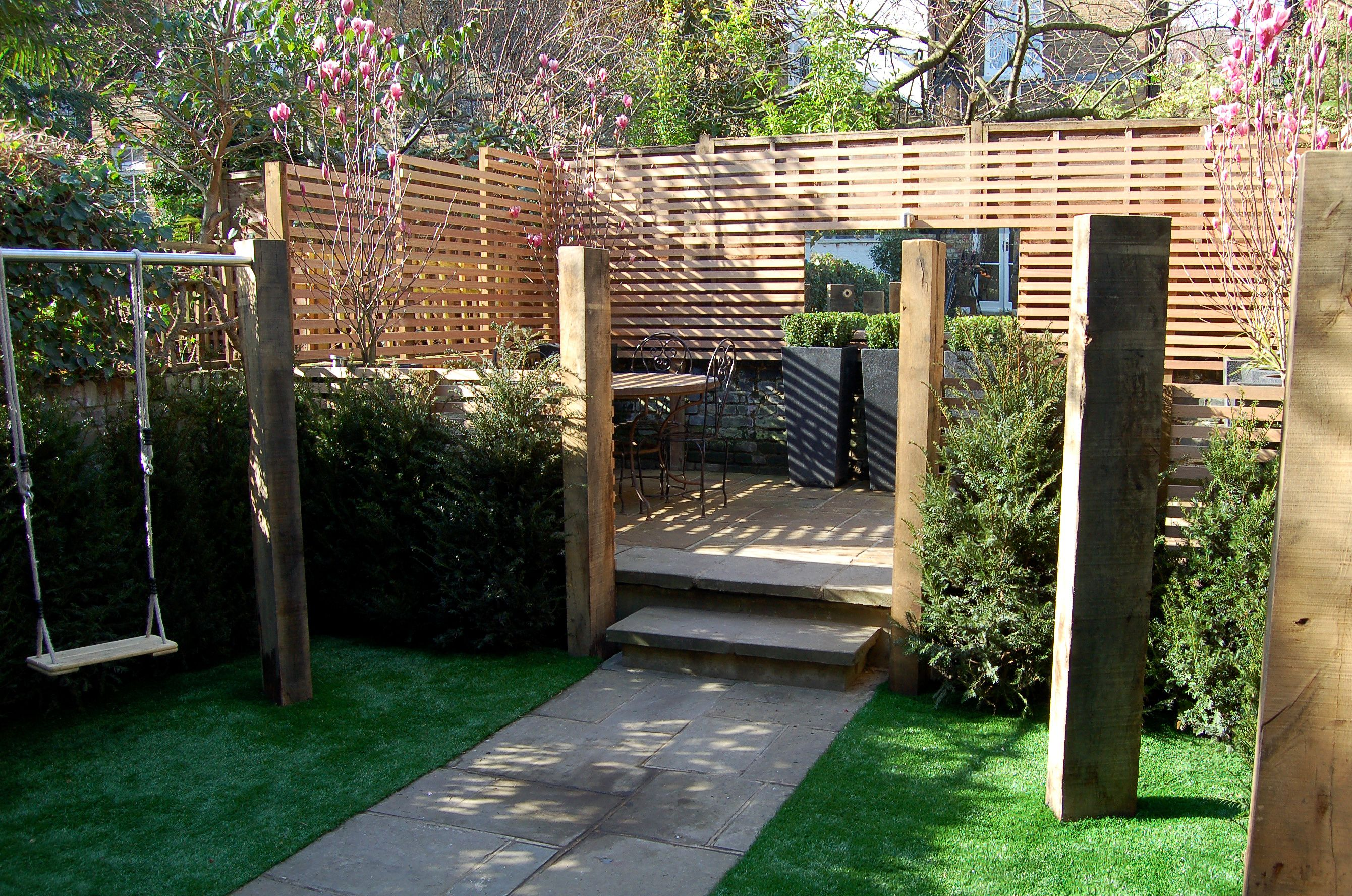 swings monkey bars and a climbing wall incorporated into the