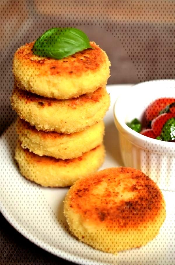 Stack of cous-cous boulettes with tomato salad Tomato salad -  Stack of cous-cous boulettes with to