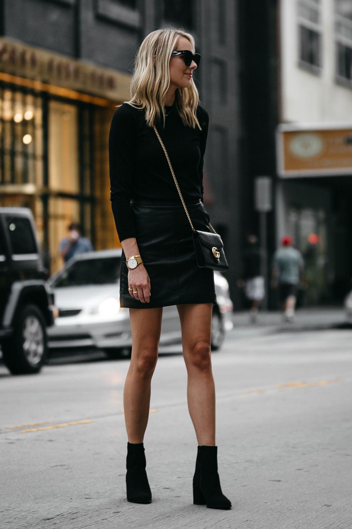 blonde woman wearing club monaco black sweater topshop