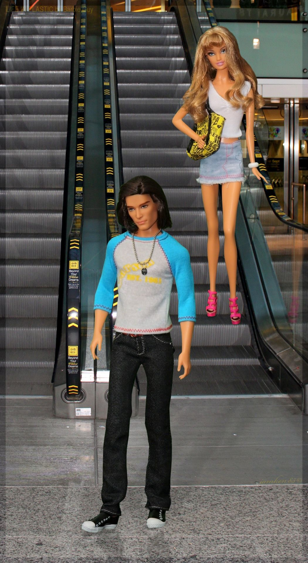 Escalator. In this photo: Barbie® Basics Model No. 15 Collection 002 and Cynthia Rowley Barbie® doll