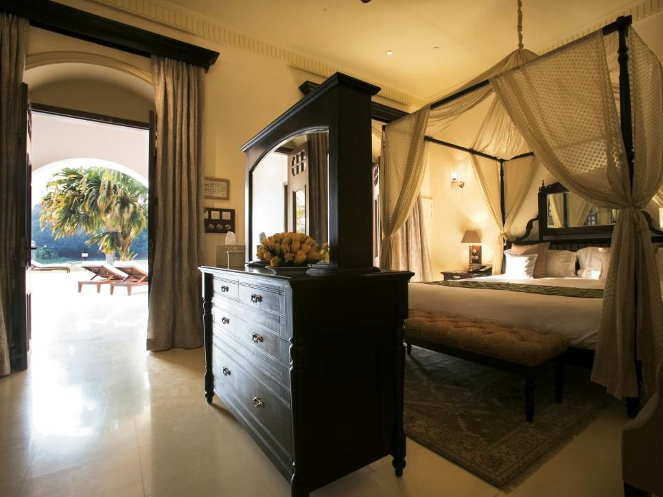 this elegant bedroom features a beautiful canopy bed dark wood furnishings and trim and - Dark Wood Canopy Interior