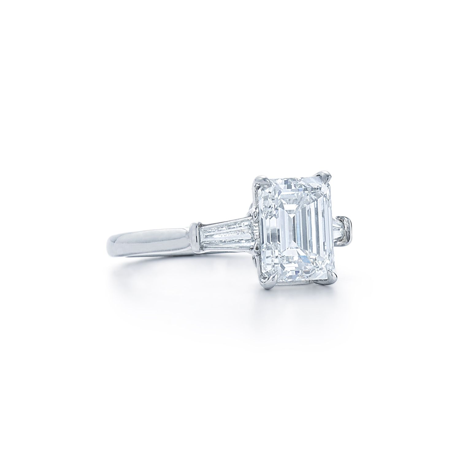 Emerald cut diamond ring with tapered baguette side stones Set in