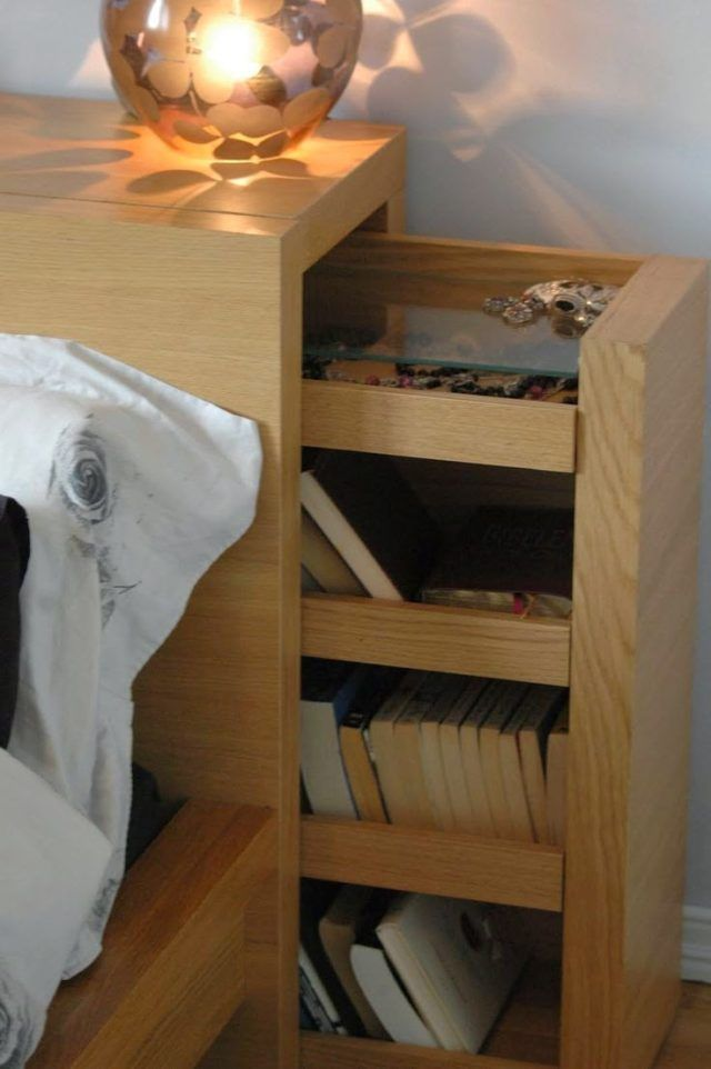 Headboard With Open Shelves And A Hidden Pull Out Storage Unit With Casters