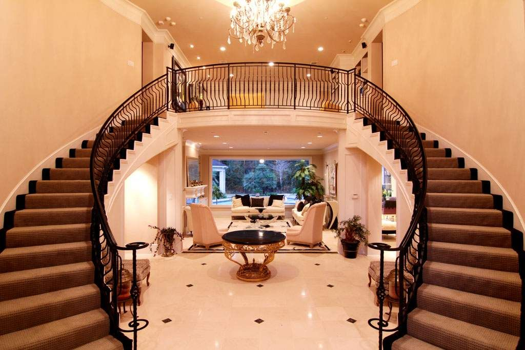 Enter through the double front doors to a grand foyer with ...