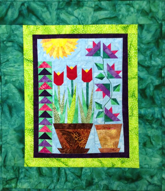 Think Spring paper pieced wall hanging
