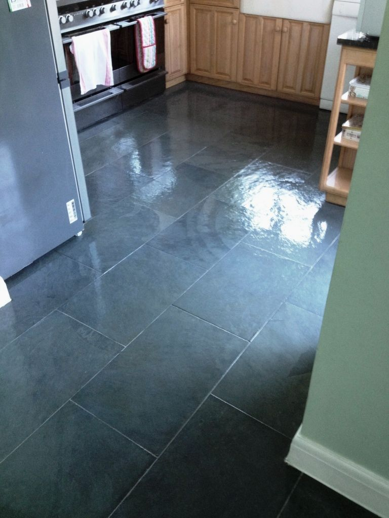 This slate floor was installed in the kitchen and adjacent dining ...