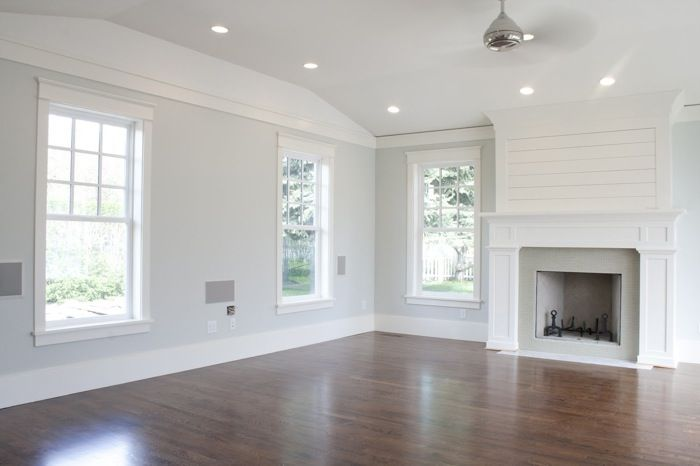 Den Family Room Living Room Light Gray Walls With White Trim Wood Floors Let The Room Be Beautif Grey Walls