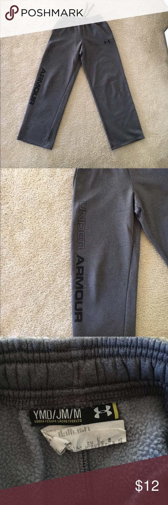 Under Armour sweatpants youth M Fleece lined Under  Armour  sweatpants. Inside shows balling of fleece from wash. There is a small mark on the front left leg. It looks like a pencil mark that may come out in the wash. Not sure.  ( as shown in pic) Otherwise outside is in perfect condition Side pockets elastic and drawstring waist. 26 inch inseam. Never dryer dried. Under Armour Bottoms Sweatpants & Joggers