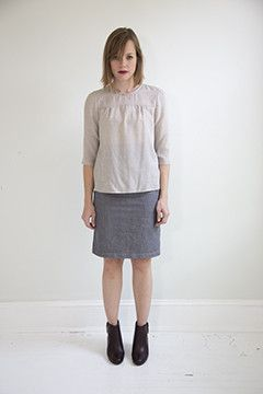 Pleated proper top on www.nanadc.com in lightweight sand cotton blend. Gathers under the yoke. Sleeves hit just below the elbow.