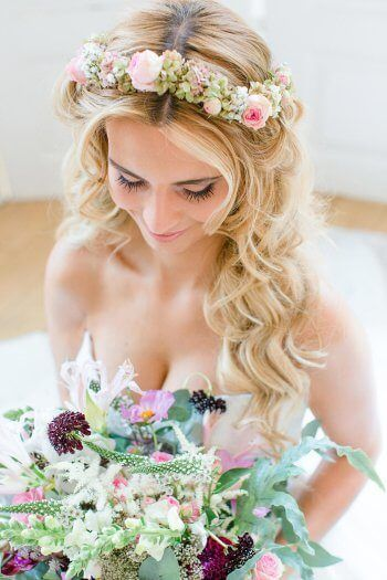 Photo of Open bridal hairstyle with floral wreath I Large picture gallery