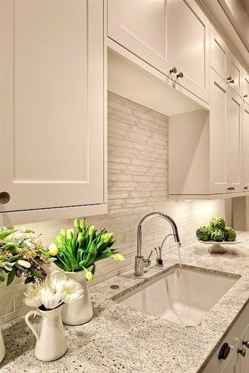 Lovely creamy white kitchen design with shaker cabinets painted benjamin moore dove kashmir granite counter tops polished nickel also rh in pinterest