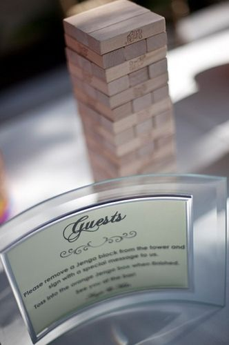 A unique twist for a guest sign in book... have your guest sign in on a wooden Jenga piece. What fun it will be to play each year on your anniversary!
