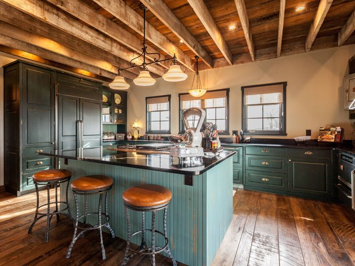 Sarah natsumi moore pinterest rustic kitchen beams and ceiling green rustic kitchen with stunning custom lighting and beamed ceiling aloadofball Images
