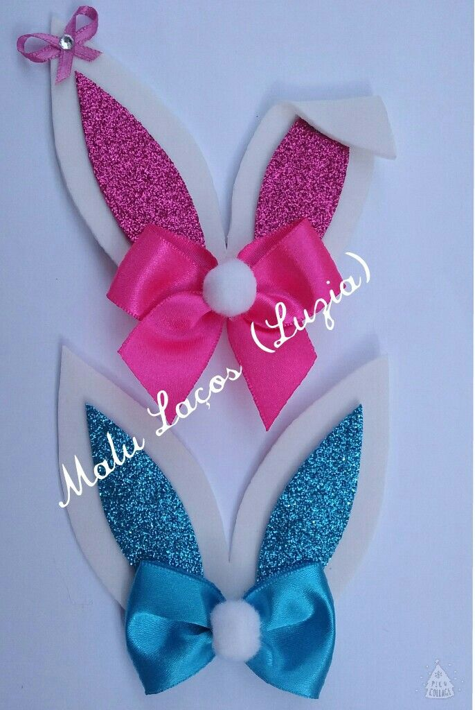 Bow made of satin ribbon with white pompom and ears in Eva