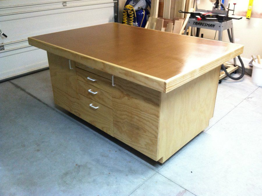 Torsion box table saw outfeed assembly workbench by for Table saw workbench woodworking plans