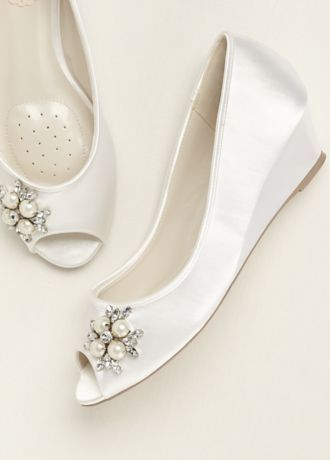 753f4f74914 Peep toe with small wedge for height and comfort with small pearl and  crystal trim. Materials  White Satin. Heel  1 3 4 in. Wedge Imported.