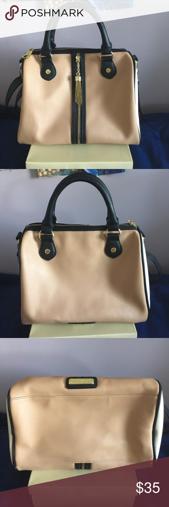 Steve Madden Satchel Used a couple of times but still in good condition! No stains, rips or discoloration. Has two small pockets and one large pocket inside. Has one 20in adjustable strap. Body of the bag is 11X11. Steve Madden Bags Satchels
