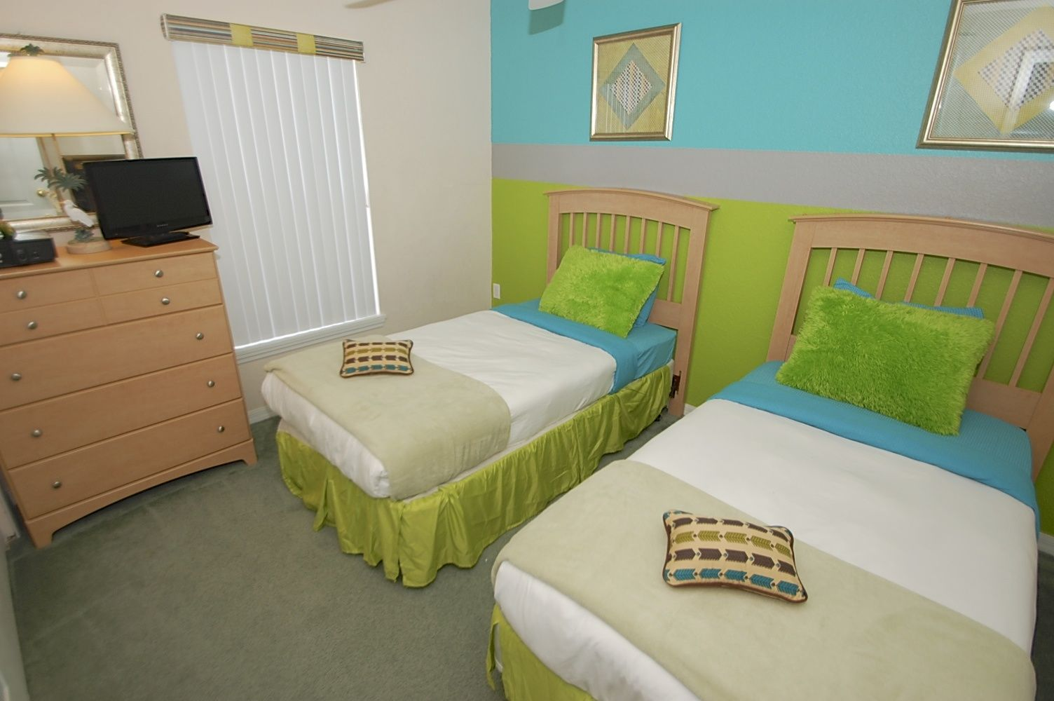 Twin bedroom with modern twist and fresh colors. 20