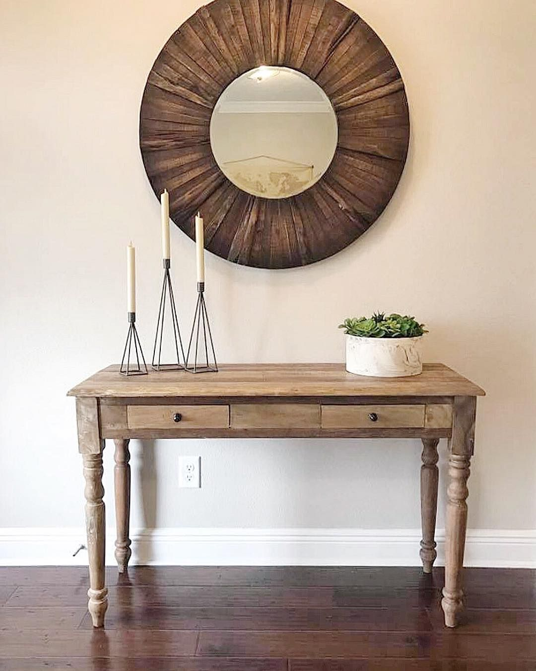 An entryway is the perfect place to showcase your homes style welcome your guests with sweet and simple touches like a natural wood table adorned with