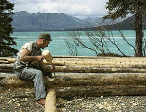 """Dick Proenneke notching logs for the cabin walls. ~ """"Alone in the Wilderness"""" documentary of one man who lived his dream in the Alaska wilderness."""