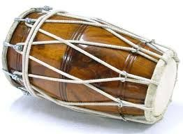 The Indian Instrument - Dholak. The Dholak is a South Asian two-headed hand-drum. It may have traditional cotton rope lacing, screw-turnbuckle tensioning or both combined. In the first case steel rings are used for tuning or pegs a twisted inside the laces.