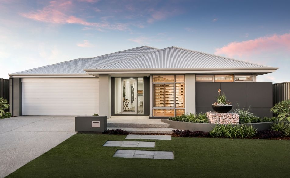 Modern elevation with cladded feature wall, rendered facade and ...