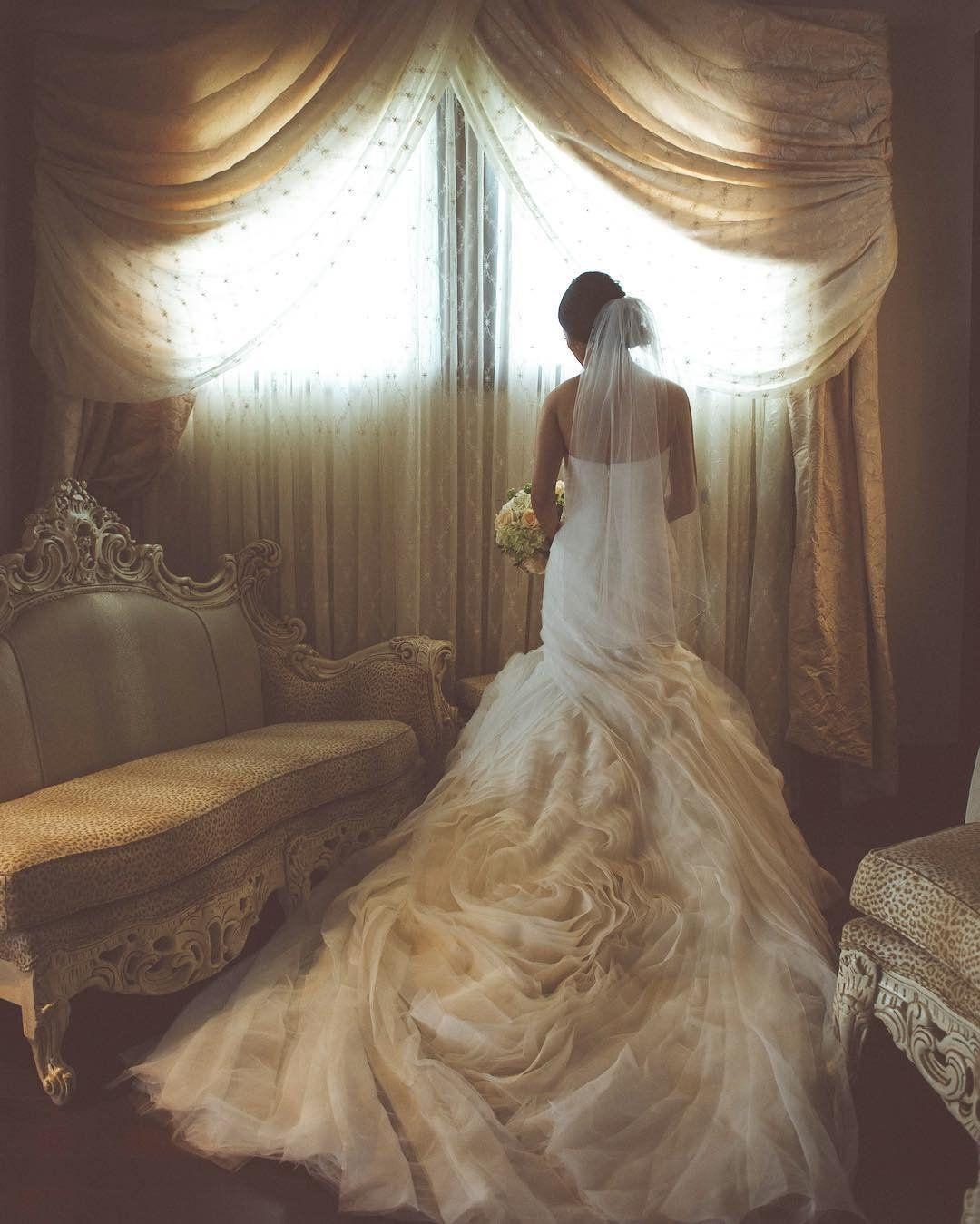 3a3af904d5f5 A quite pre-wedding moment in WHITE by Vera Wang strapless mermaid wedding  dress with an extra long train. Shop this look at David's Bridal   Photo by  Dan ...