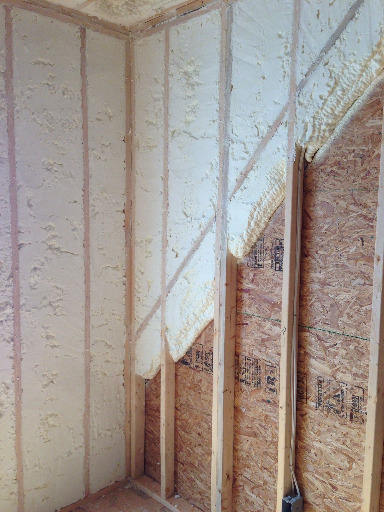 Open Cell Spray Foam Insulation Installed Into New House Exterior