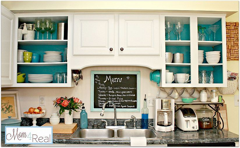 Open Kitchen Cabinets With Aqua, White, Lime Green, And Silver Accents.