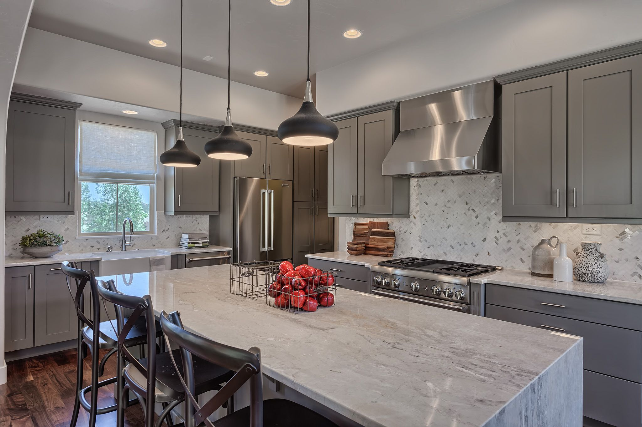 This LaBellezza Kitchen features grey cabinetry granite
