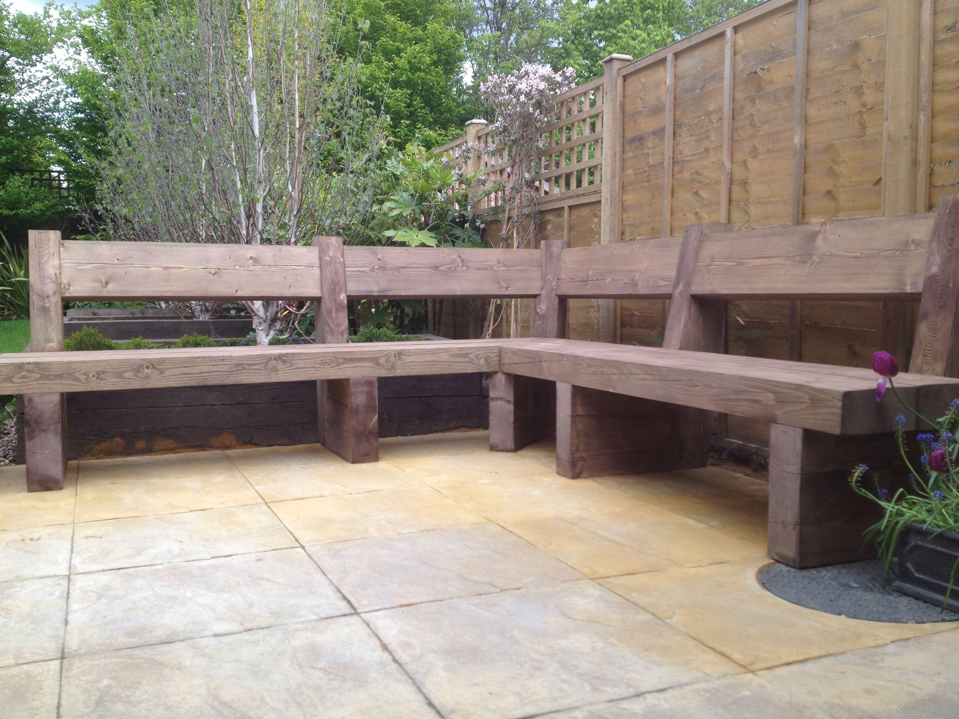 Sleeper bench corner seating in garden N8 Pergola