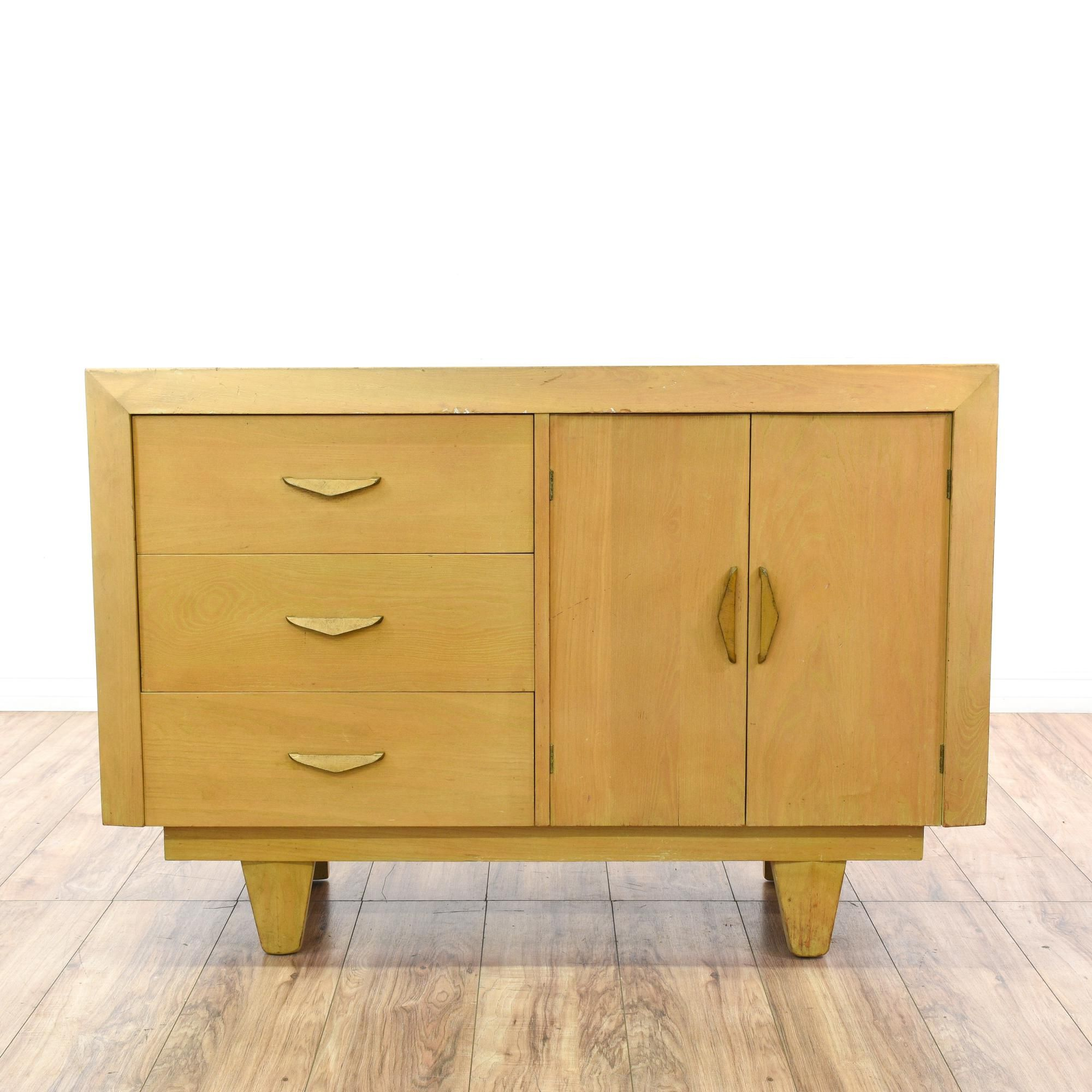 This mid century modern sideboard buffet is featured in a solid wood