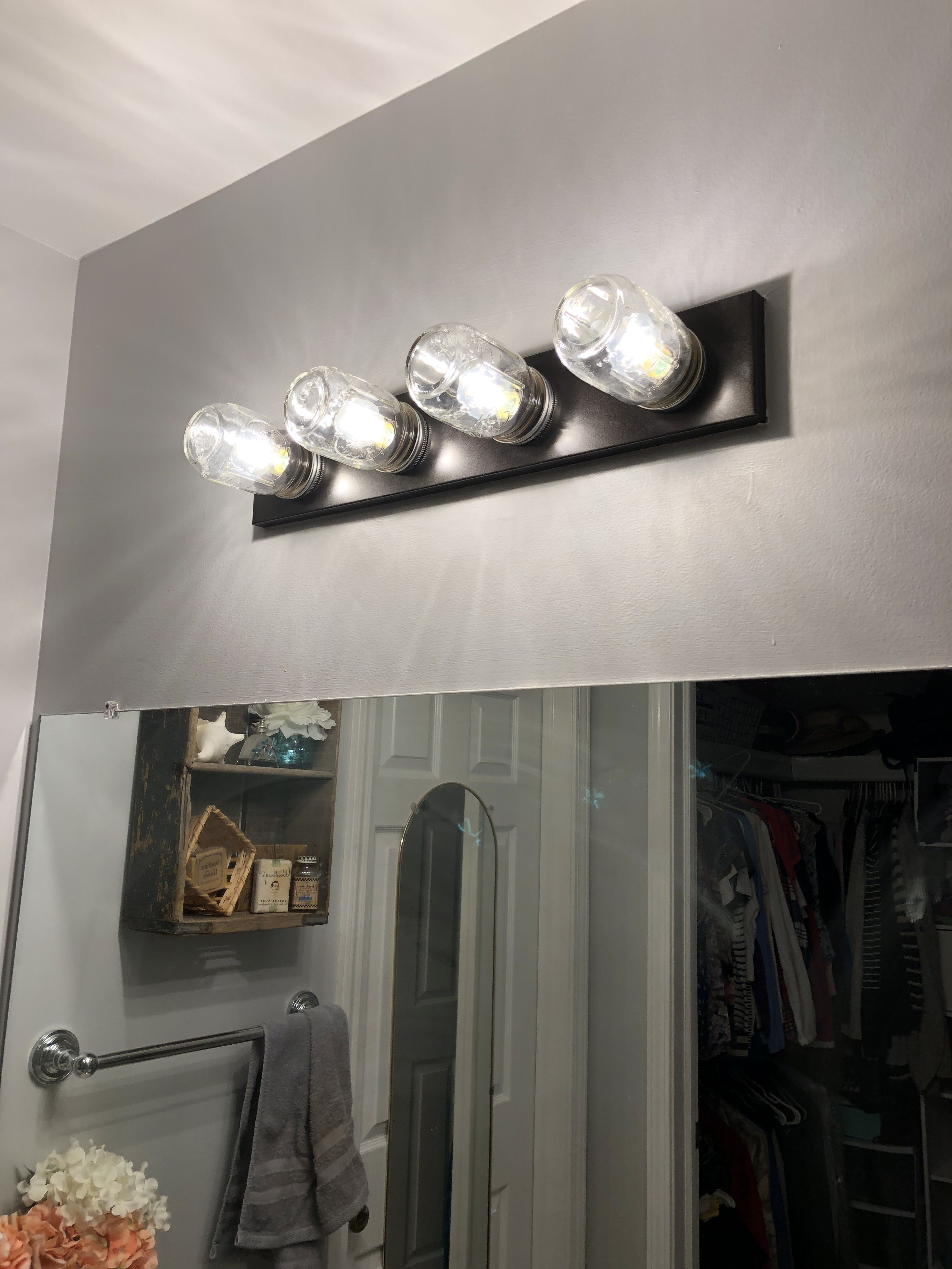 Ugly hollywood builder light fixtures in your bathroom update by screwing in mason jars