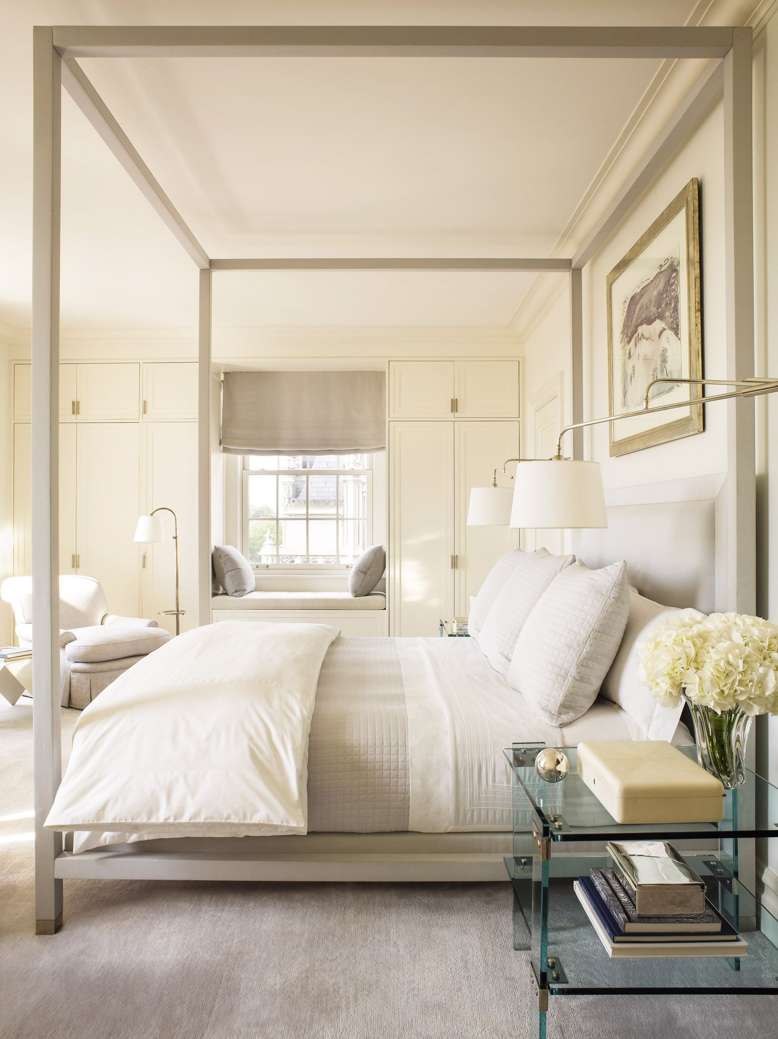 Elegant Peaceful Cream Master Bedroom With Black Out Window Shades.