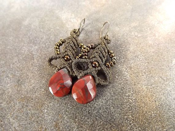 Macrame earrings with red jasper briolette gemstones and metallic seed beads in brown iris. The ear wires are hand made of niobium in gunmetal color.  These earrings hang 2 inches long, including the ear wires.