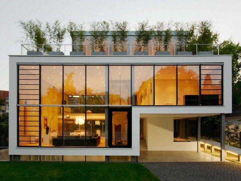 Fachadas de casas minimalistas con vidrio arq for Fachada de casas modernas con vidrio