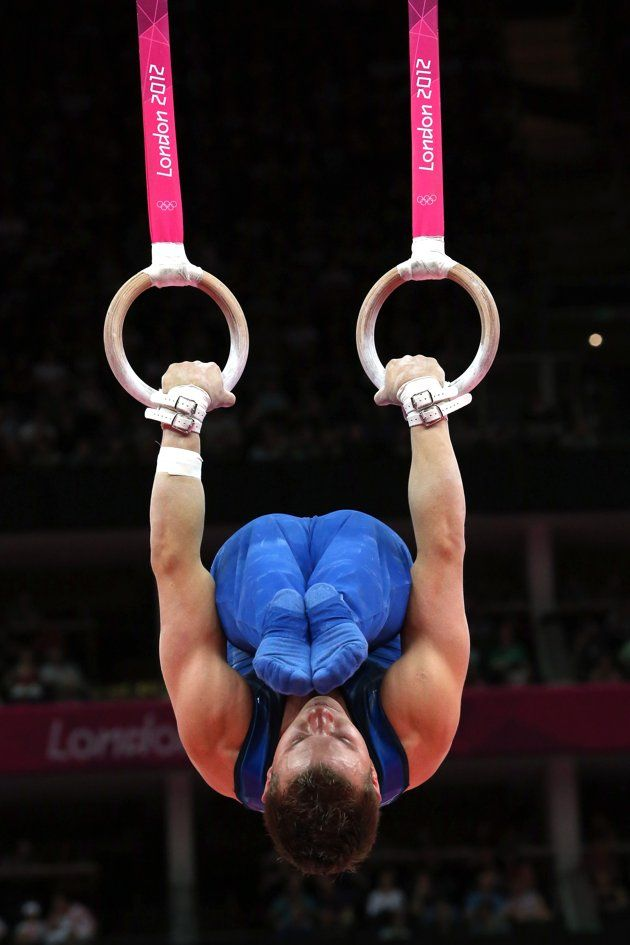 JULY 28: Jonathan Horton of the United States of America competes in the rings in the Artistic Gymnastics Men's Team qualification on Day 1 of the London 2012 Olympic Games at North Greenwich Arena on July 28, 2012 in London, England. (Photo by Ronald Martinez/Getty Images)