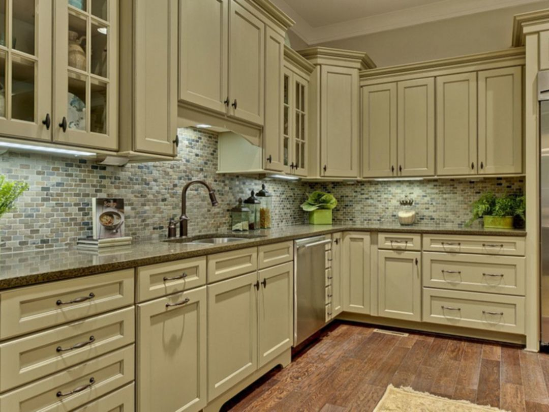 Creams And Chocolates Melt Together Making For A Truly Delectable Design In This Kitchen The So Beige Kitchen Beautiful Kitchen Cabinets New Kitchen Cabinets