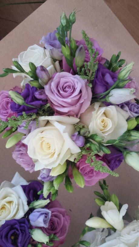 Bridesmaids Bouquet Of Dusty Pink Lilac White Roses With Lisianthus Freesia And A Dusty Pink Wedding Flowers Pink Wedding Flowers Small Flower Arrangements