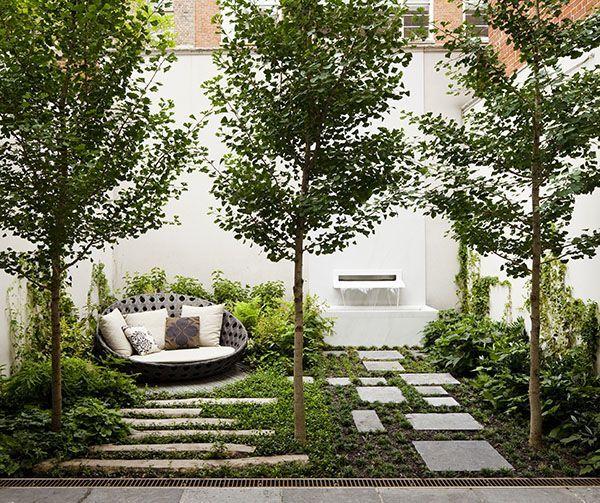 Courtyard Cushions Trees Stepping Stones Water Feature White Modern Garden Modern Garden Design Backyard Landscaping